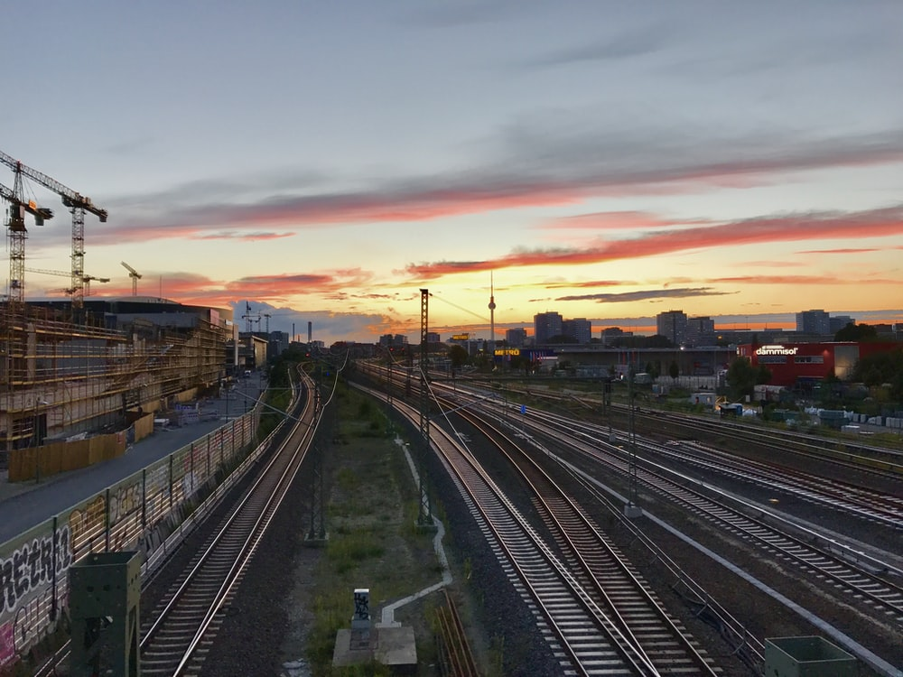 train rails closeup photography during golden hour