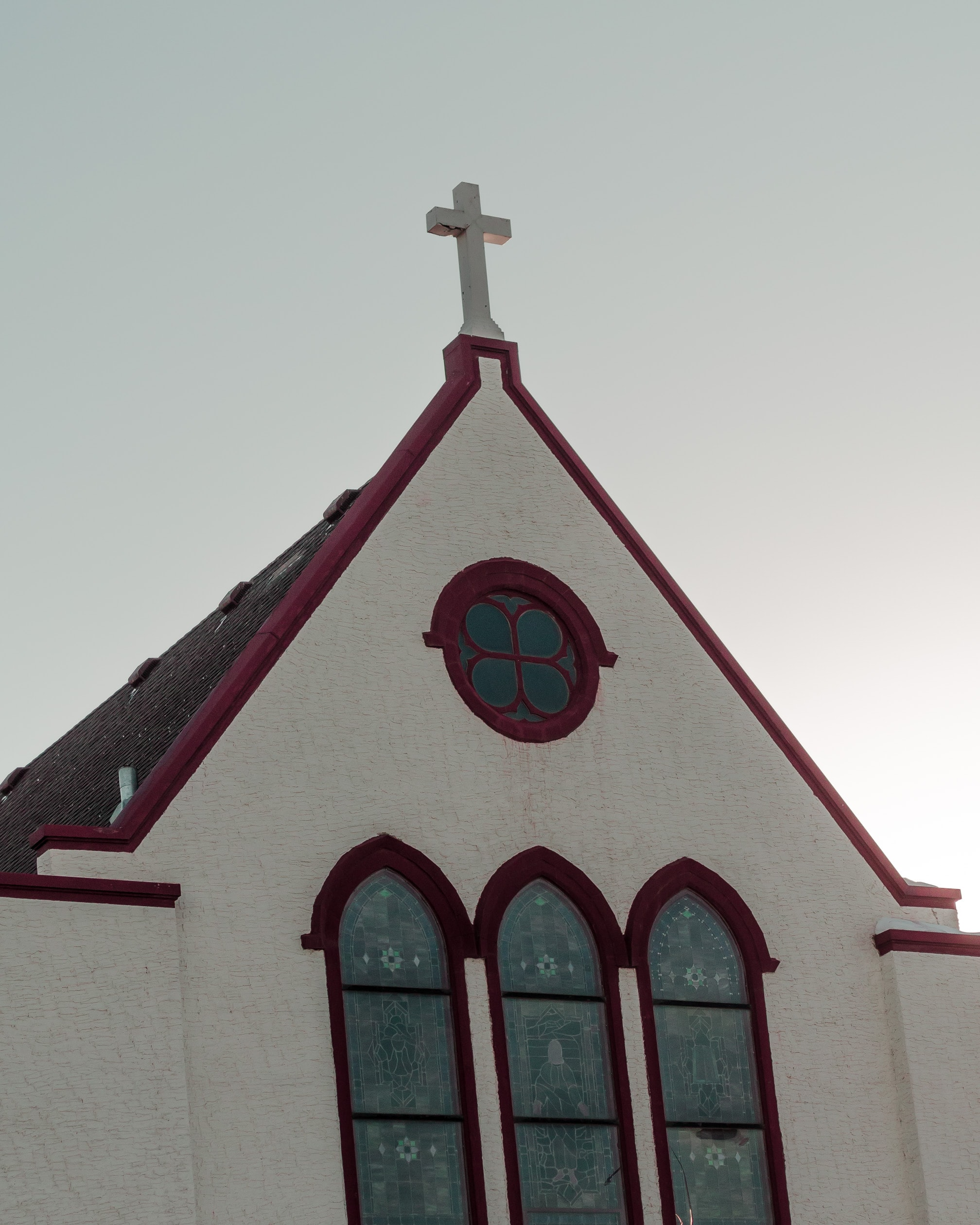 low angle of white and red painted church