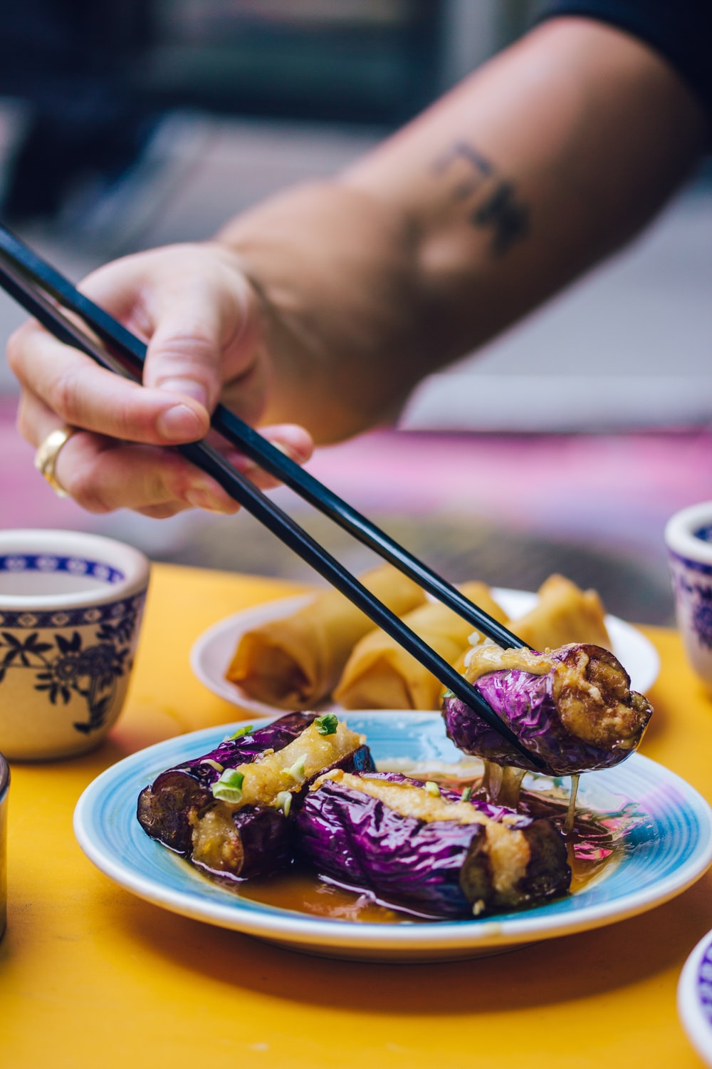 man eating food using chopsticks