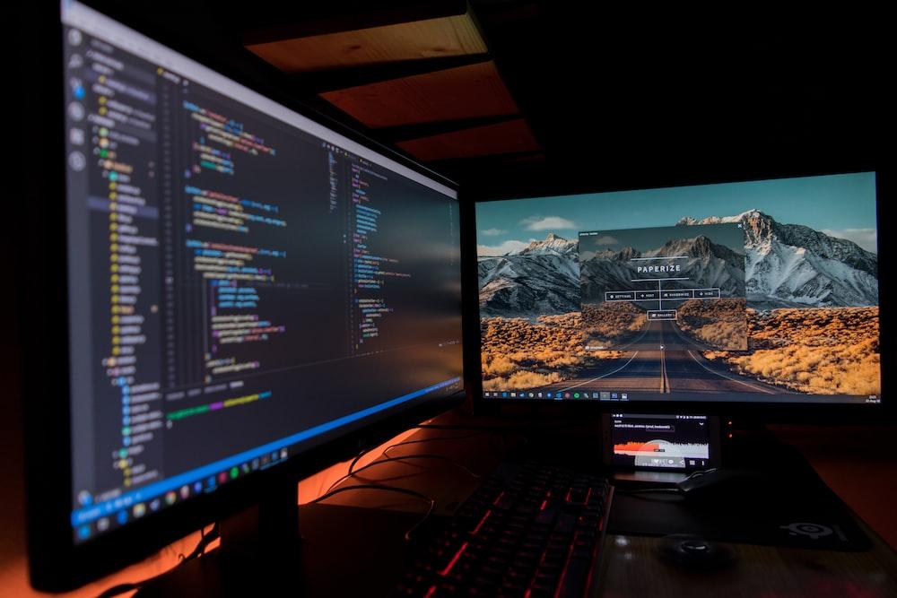 two black flat screen computer monitors