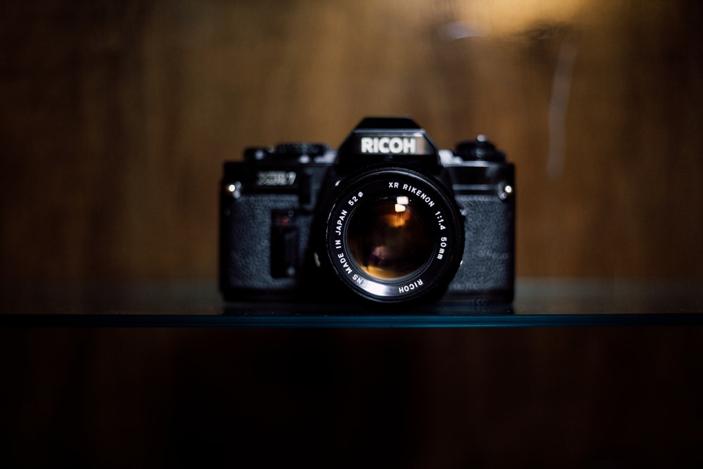 black Richo LSR camera on table