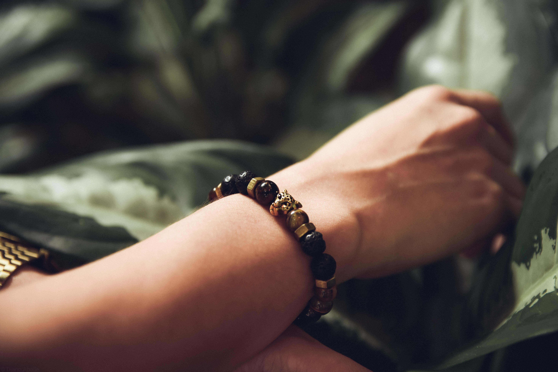person wearing beaded black bracelet