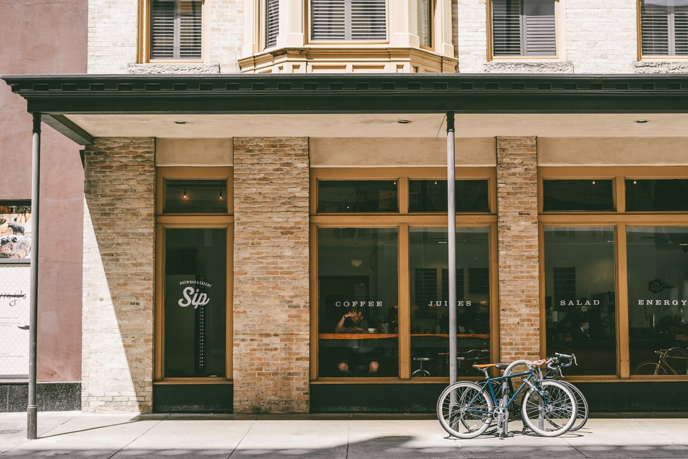 two bicycle parked near brown building