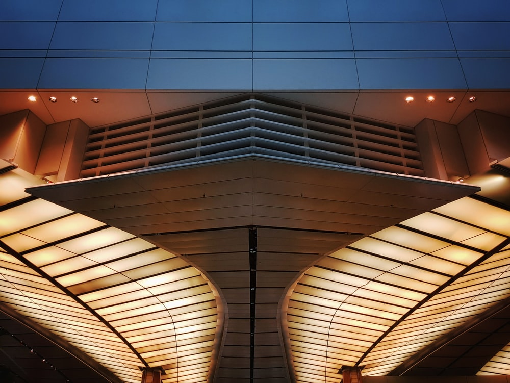 low angle photo of white ceiling structure of a building