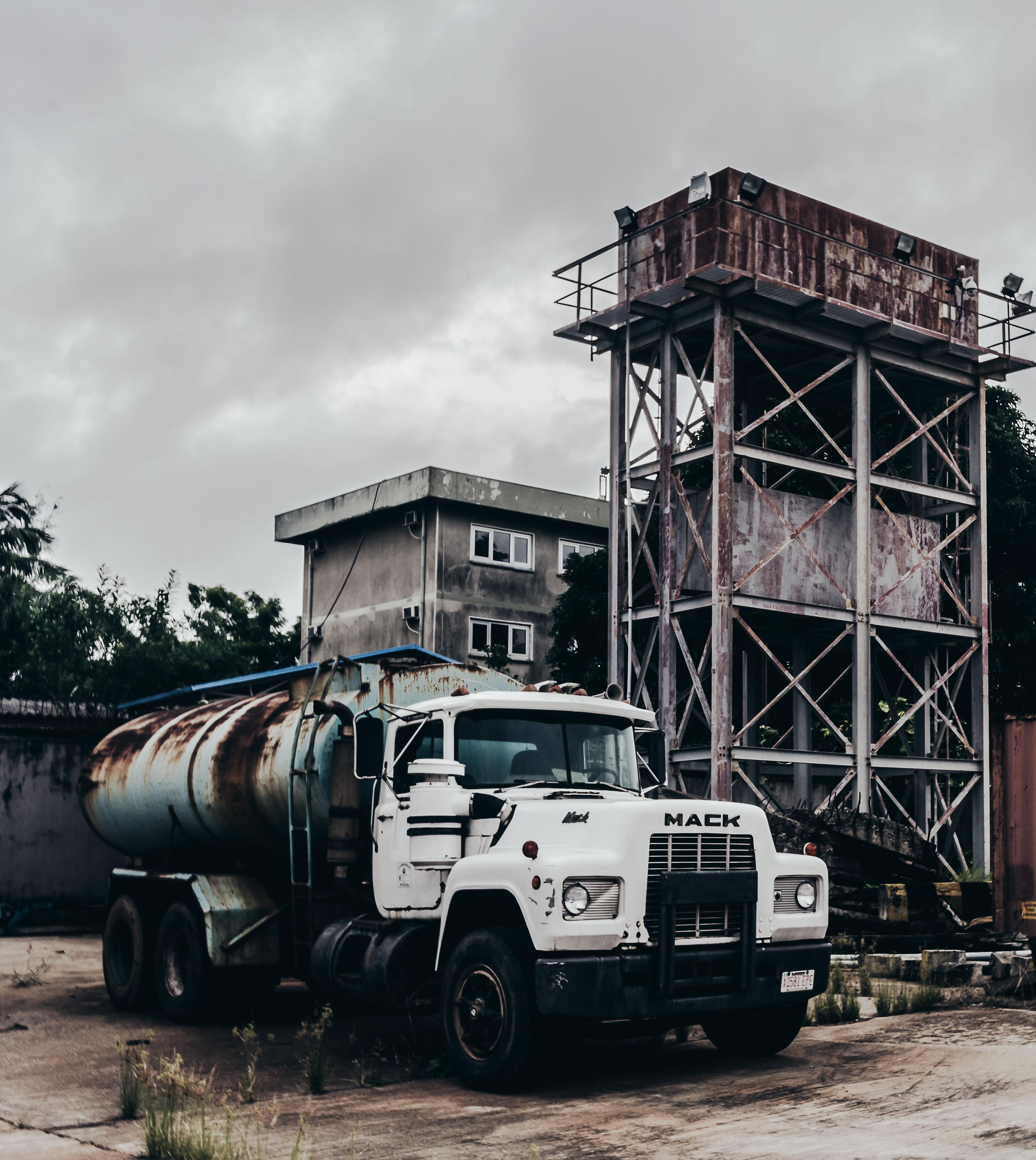 white Mack tanker truck near building