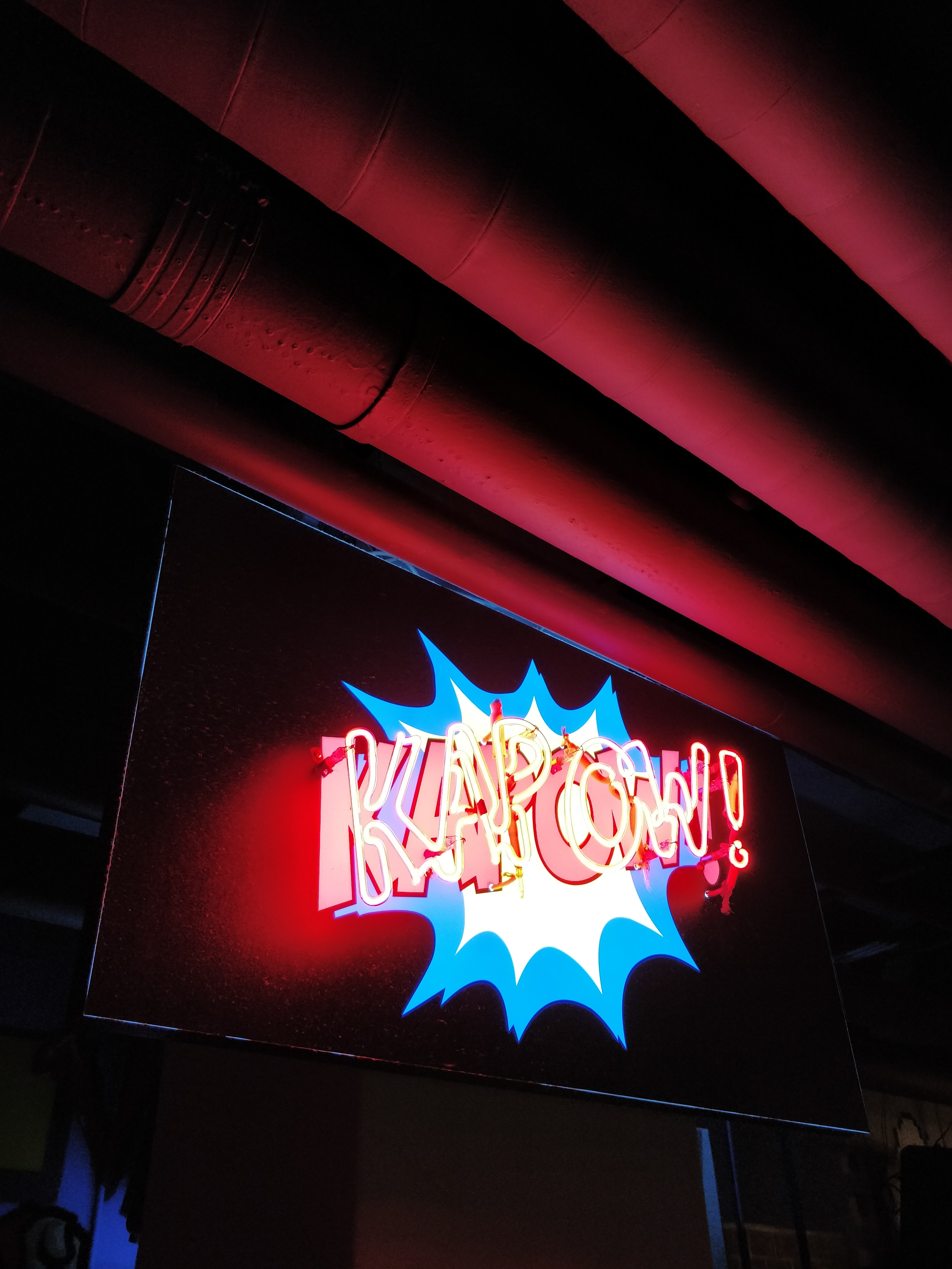 turned-on yellow and blue kapow! neon sign