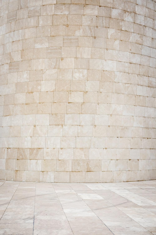 beige bricked wall