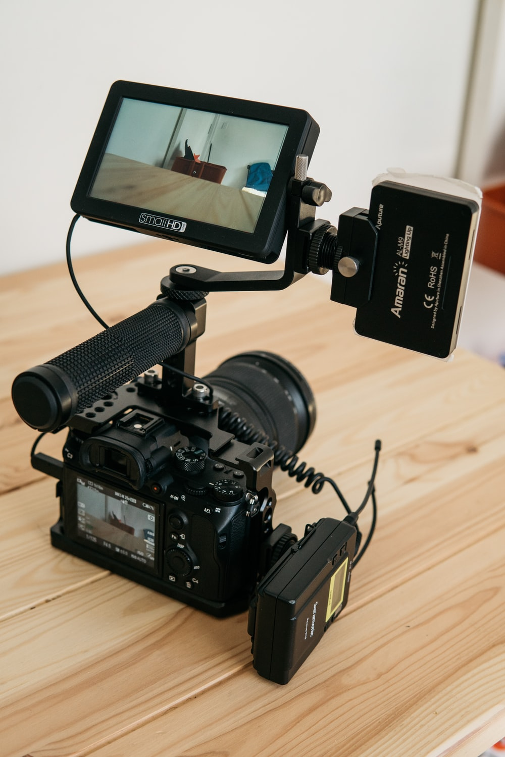 turned-on DSLR camera and displaying table top