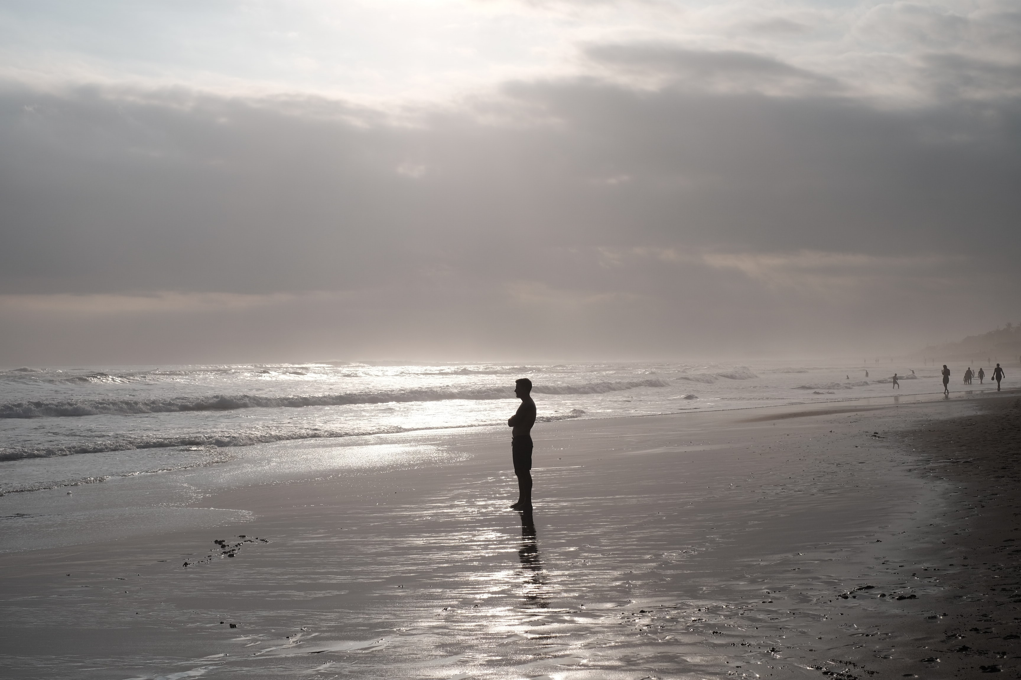 silhouette of man standing on beach