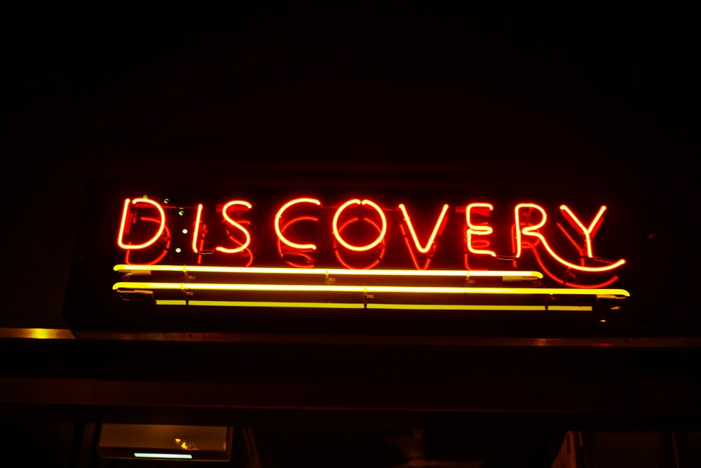 lighted red Discovery neon signage