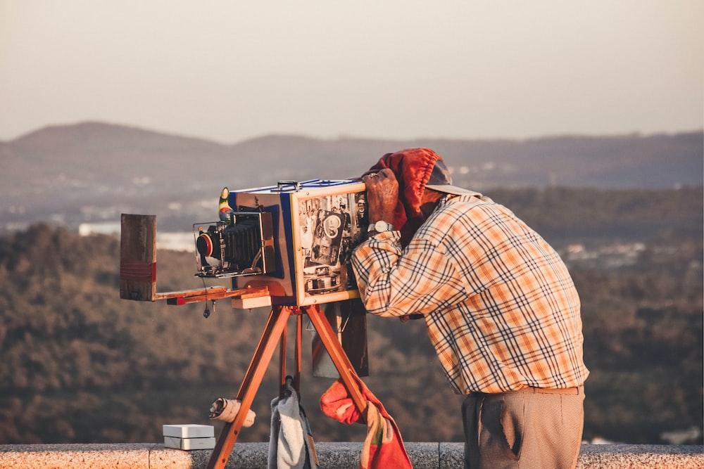 person using folding camera