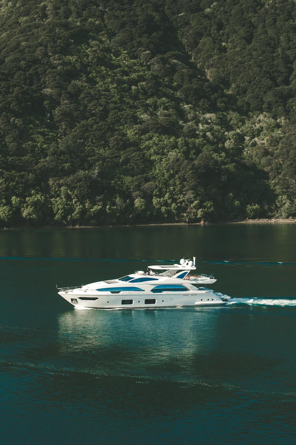 birds eye photography of yacht on body of water