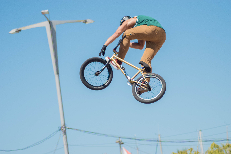 man performing bike stand