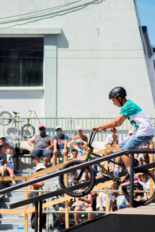 boy riding green BMX bike