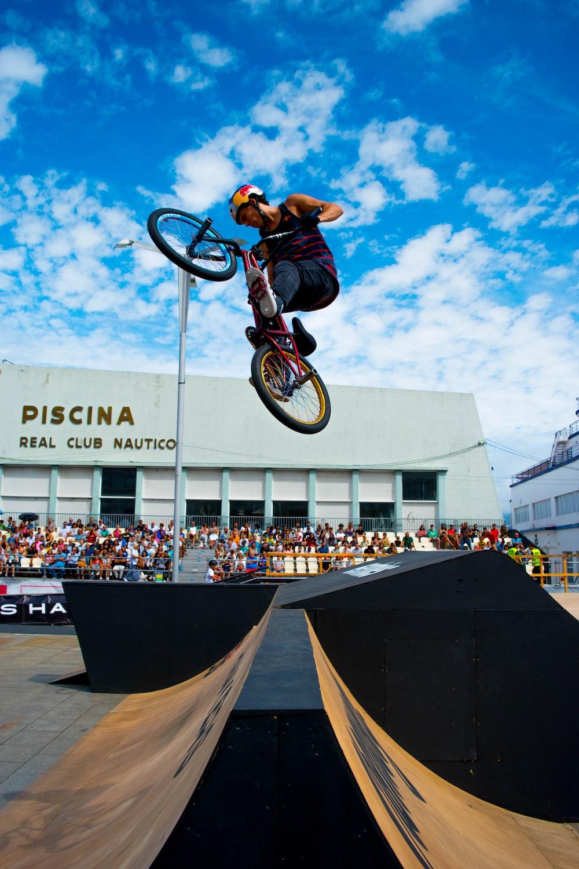 man riding bicycle above ramps during daytime