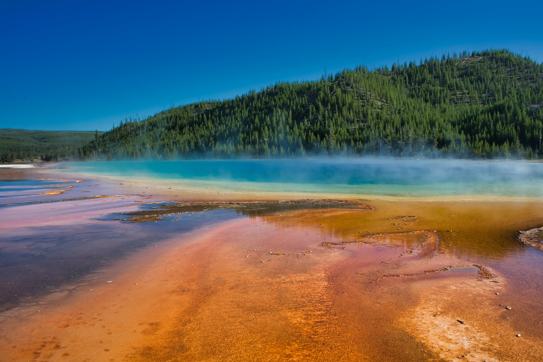 The colors of the Grand Prismatic Pool in Yellowstone National Park are stunning. The contrasts between the turquoise blue and the yellows and oranges have to be seen to be believed!