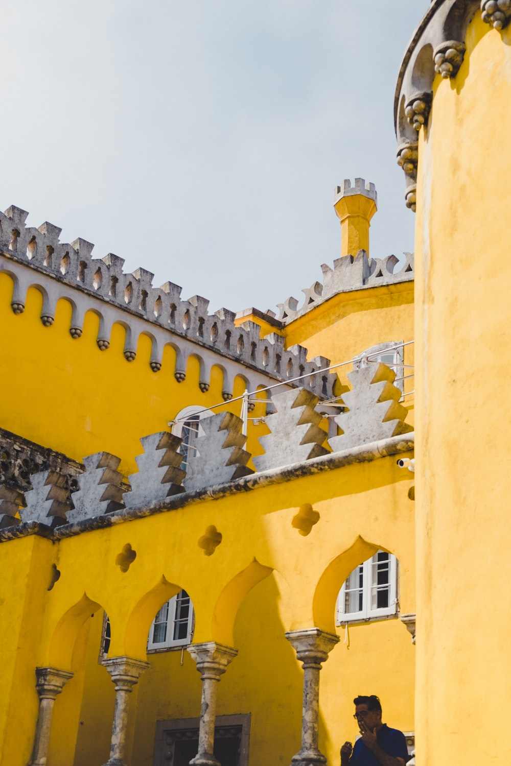 low angle photo of yellow concrete building