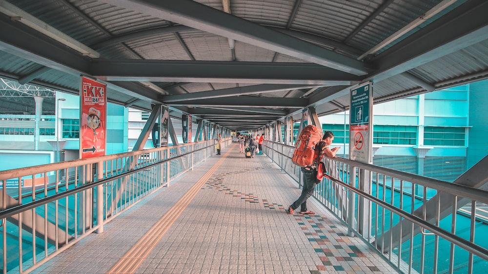 man standing on bridge
