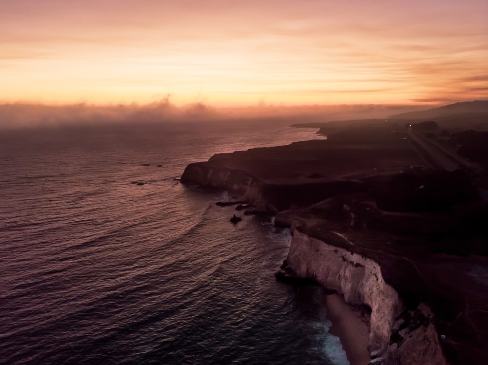 aerial photography of cliff on near sea