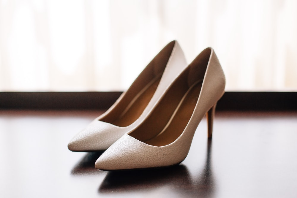 pair of women's brown pointed-toe pumps on board