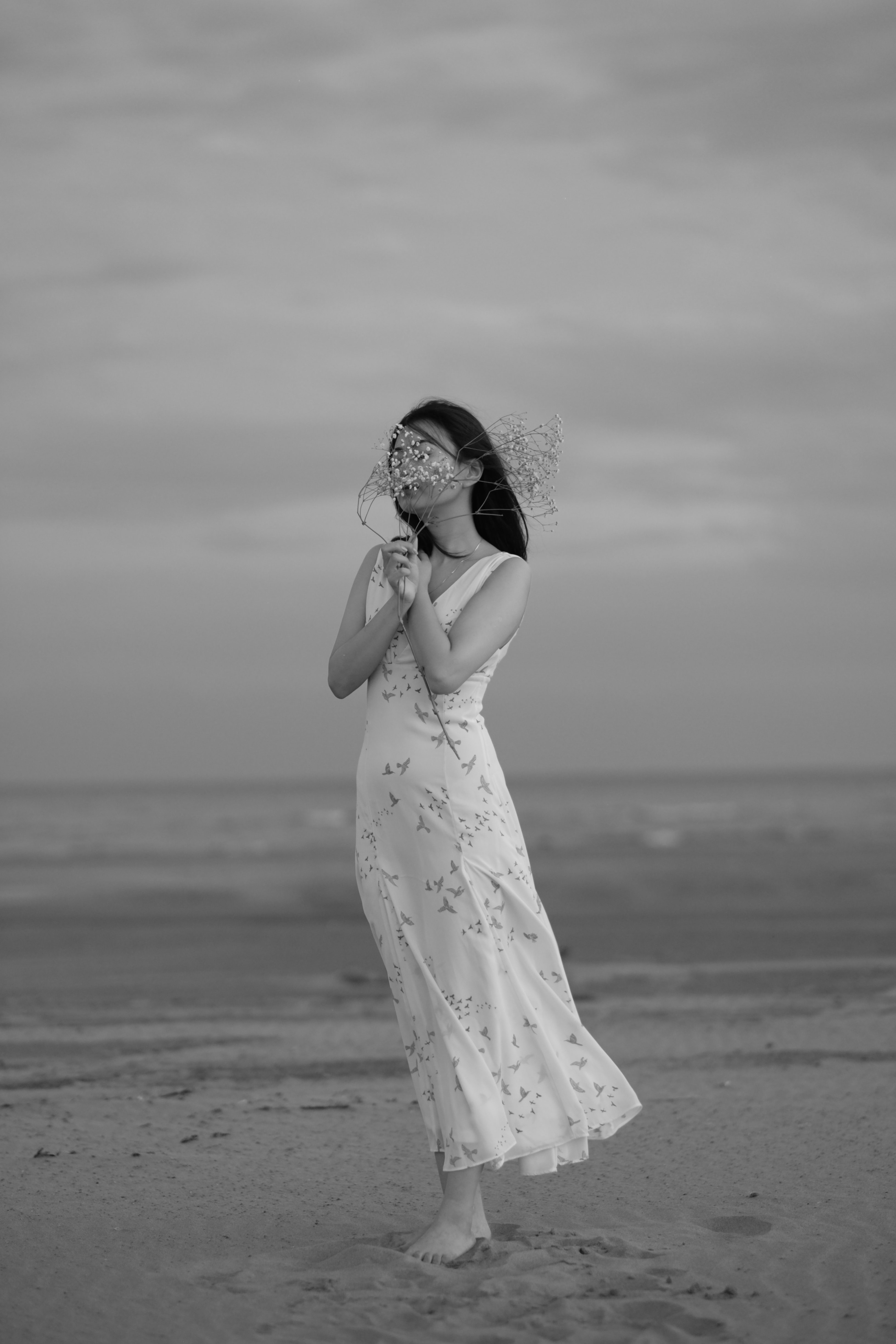 grayscale photo woman holding flower