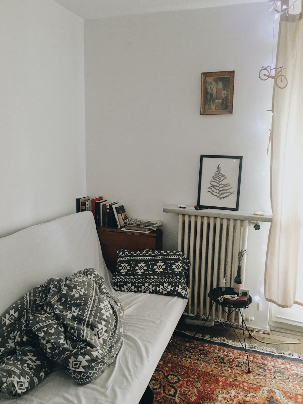 white sofa with throw pillows on wall
