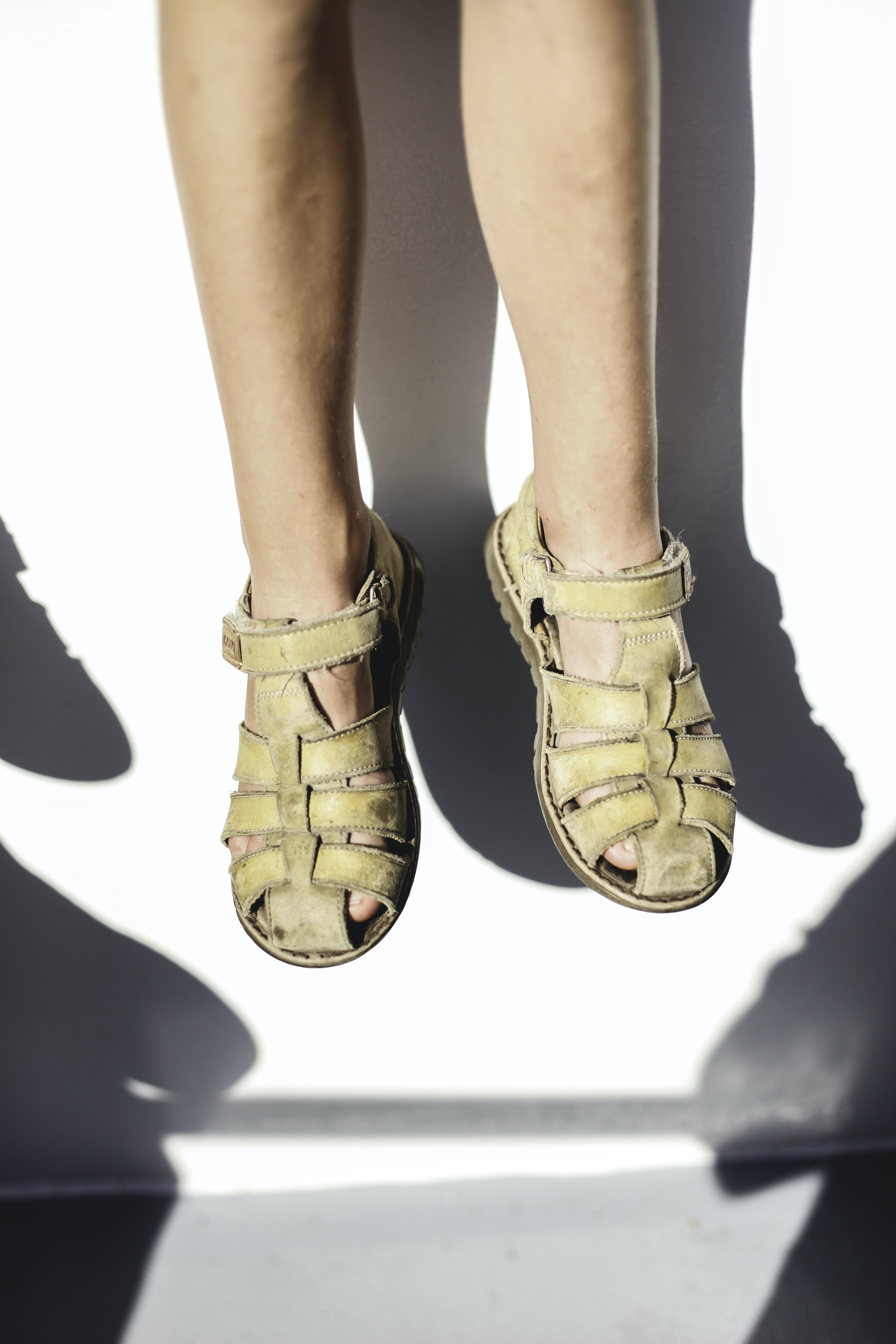 person wearing pair of sandals