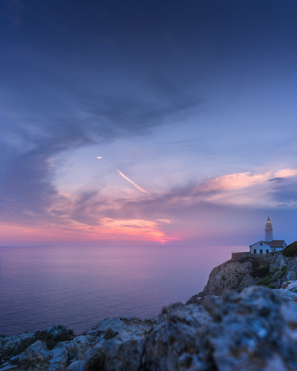 view of lighthouse atop of mountain