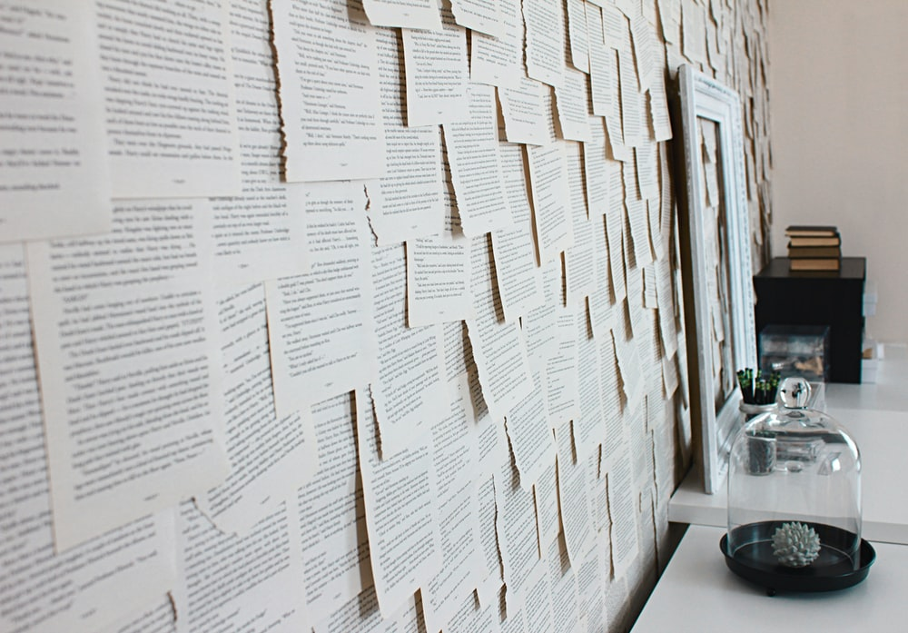 assorted paper sticked on wall