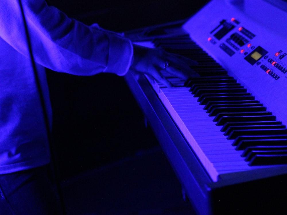 person playing keyboard