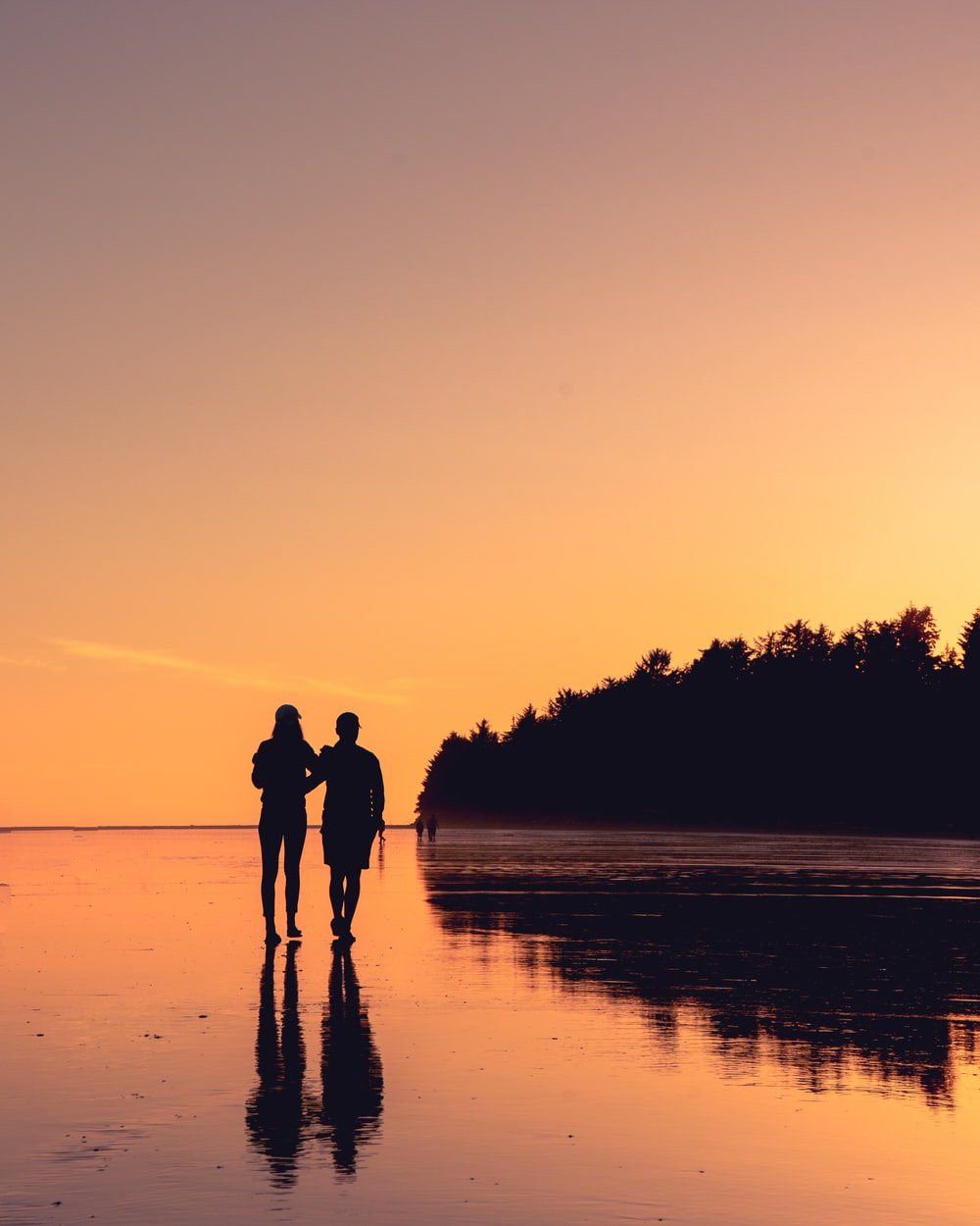 couple standing on body of water