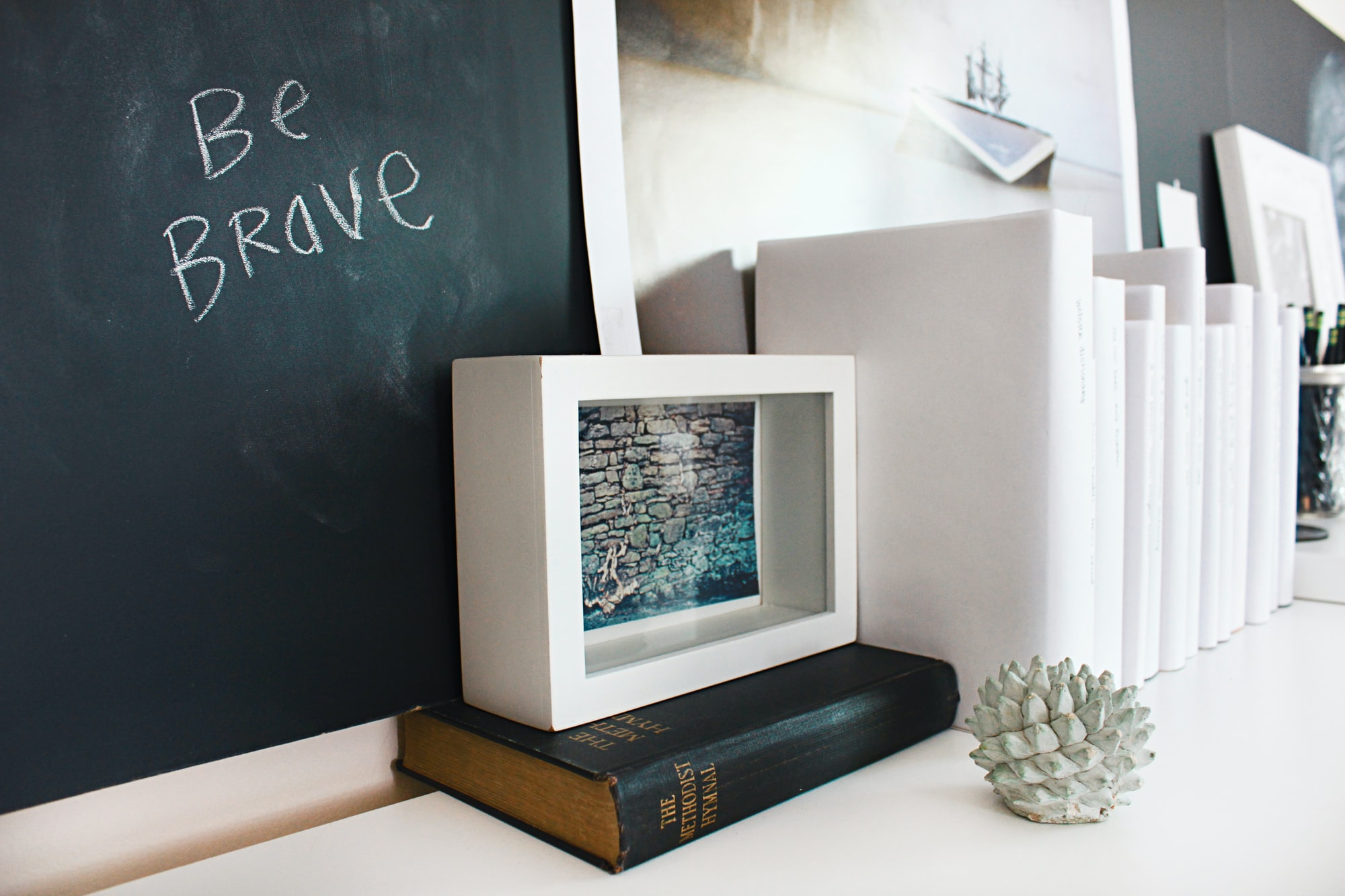 Home office with chalkboard and books