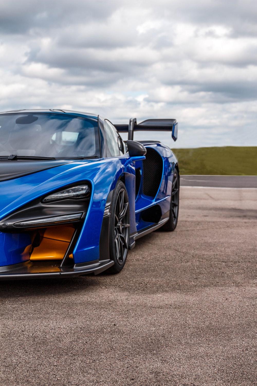 blue luxury car on roadway