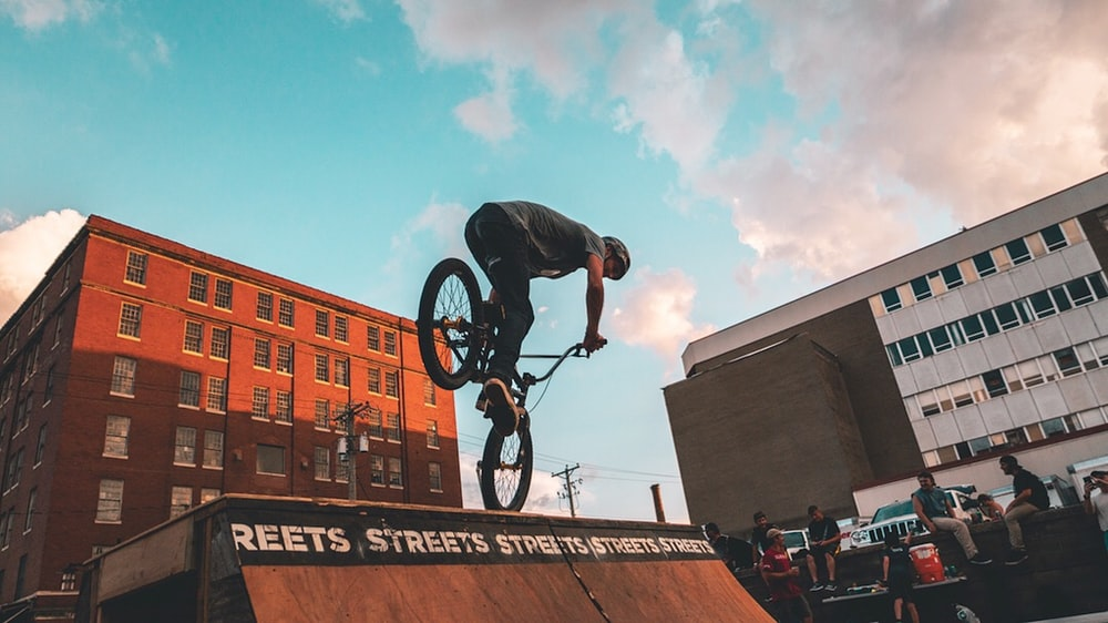 man riding bicycle on ramp