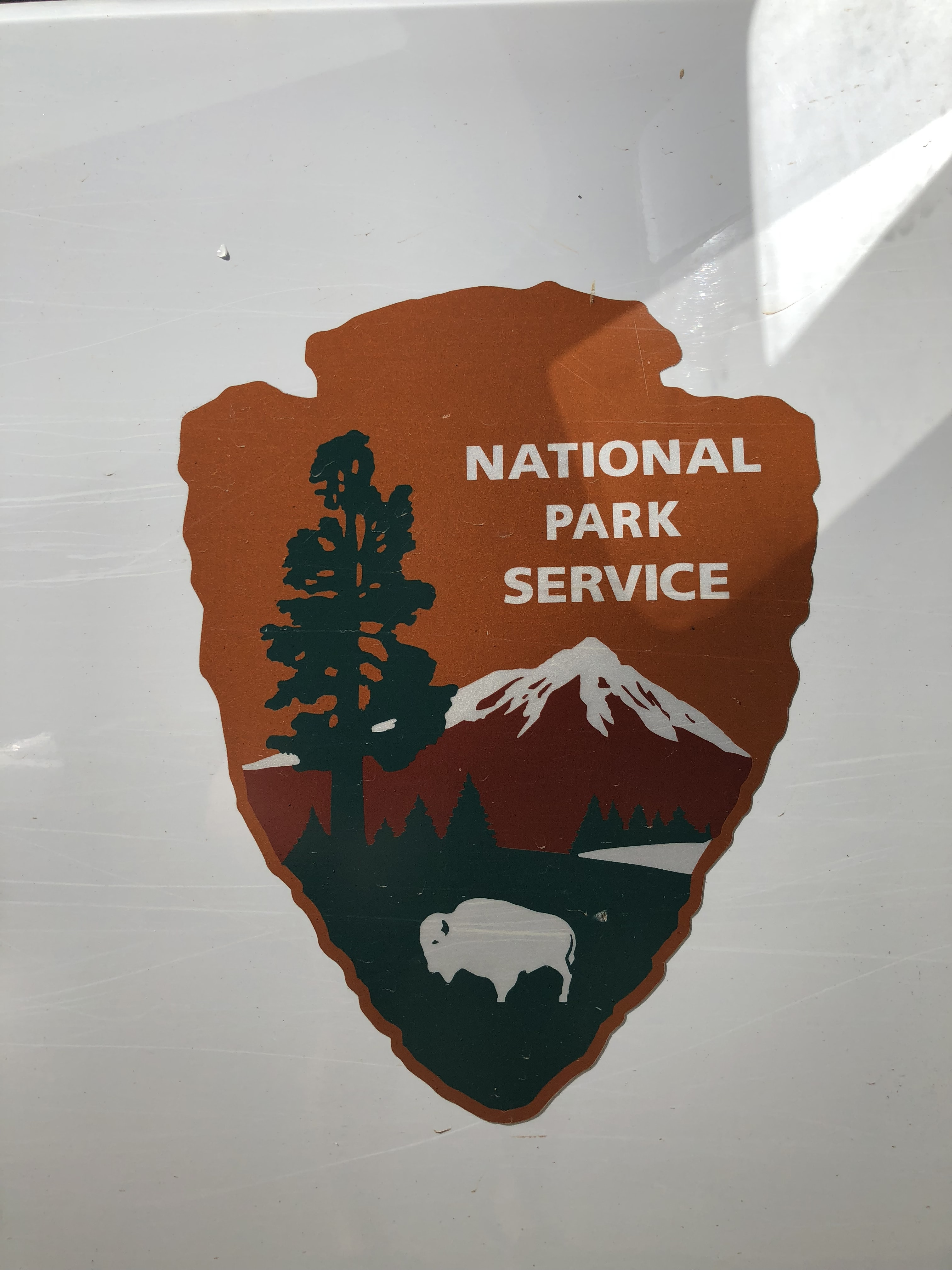 close-up of National Park Service logo