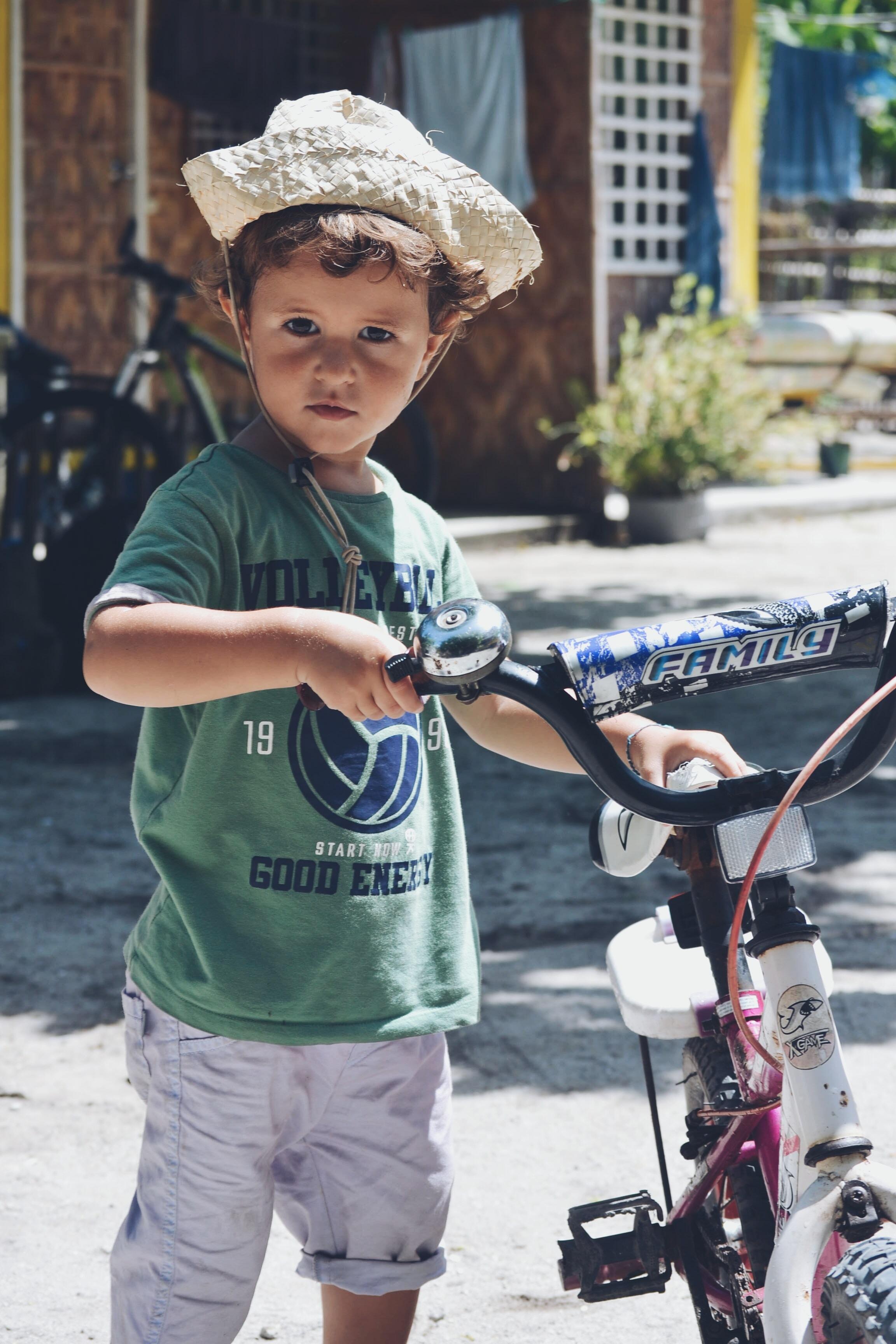 boy holding black and white bike