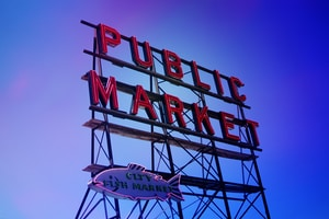 low-angle photo of Public Market signage under blue sky at daytime