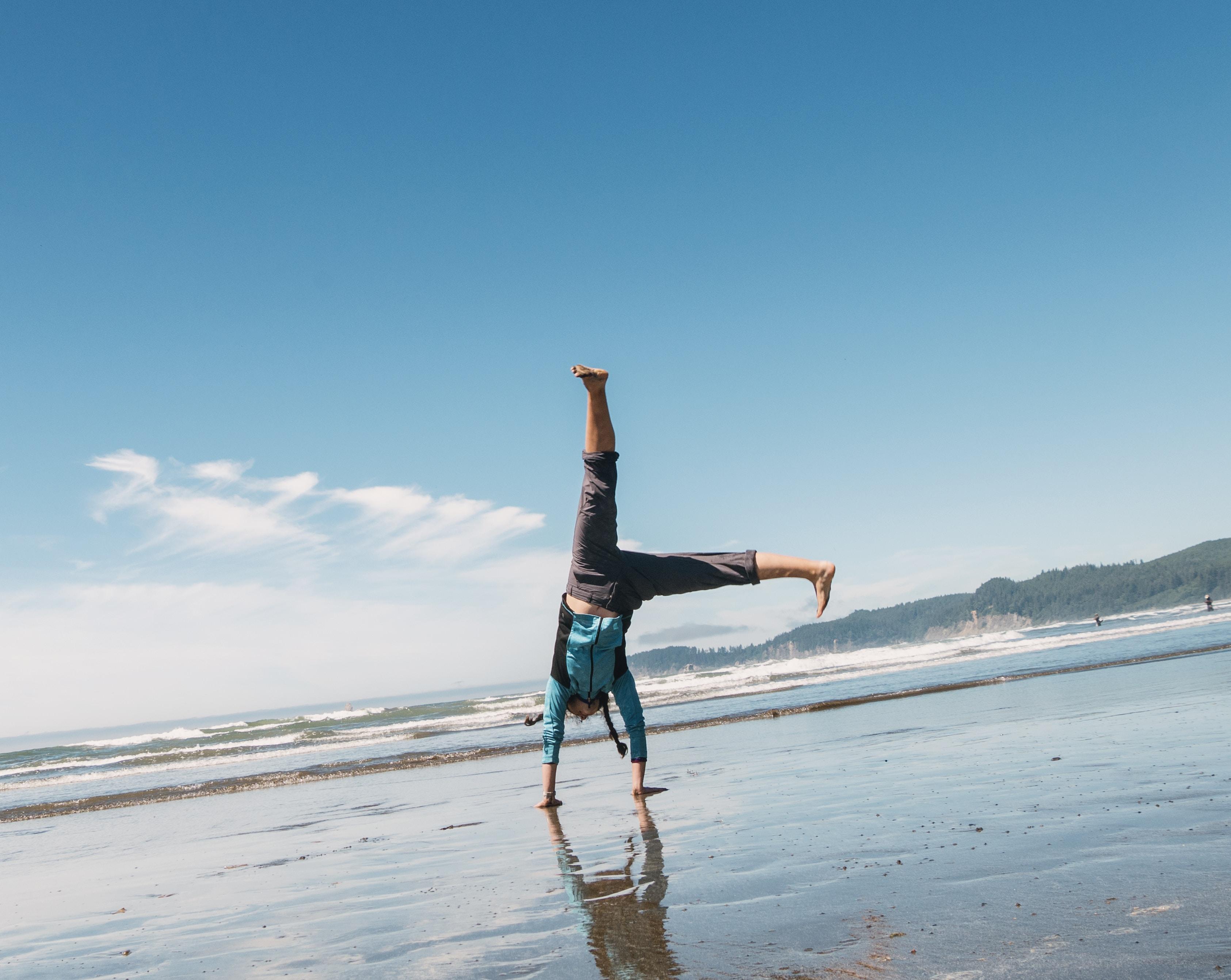 man doing a stunt on beach
