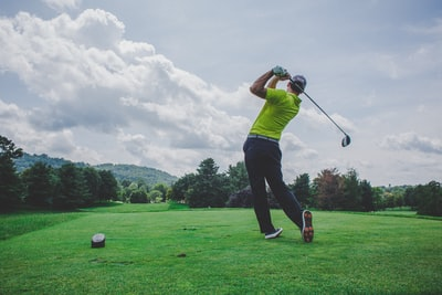 photo of man swinging golf driver golf zoom background