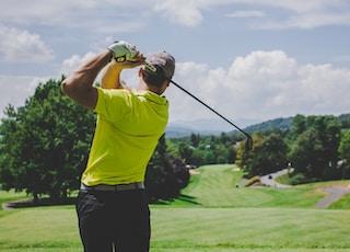 man playing golf during daytime