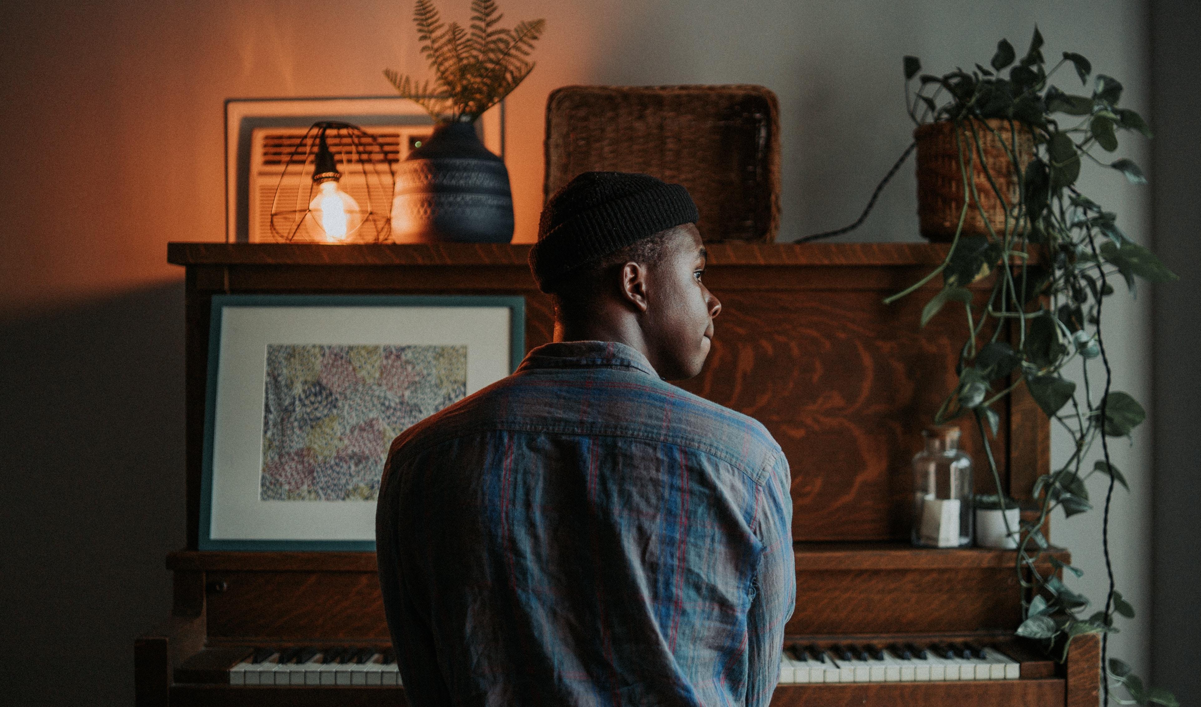 man sitting at the piano