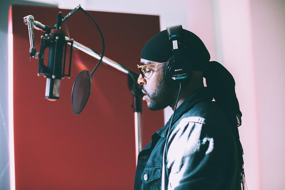 man singing infront of condenser microphone