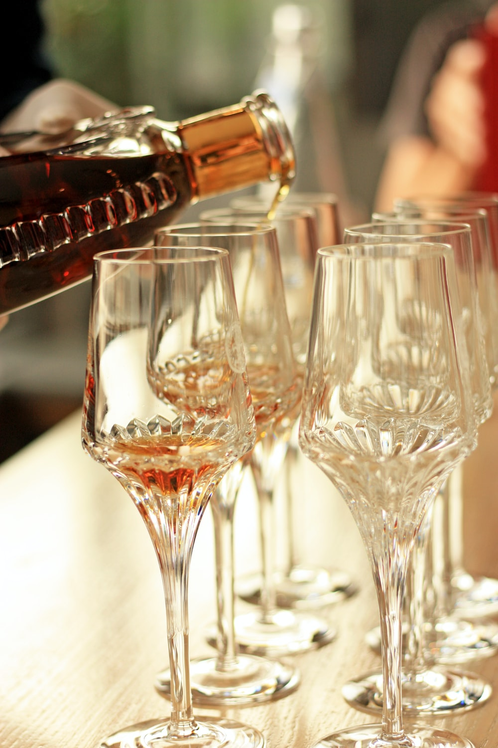 selective focus photography of clear champagne glasses