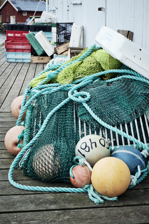 three assorted buoys