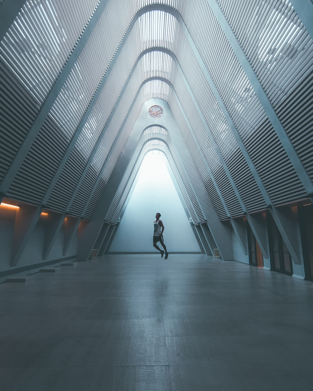 person standing inside gray metal structure