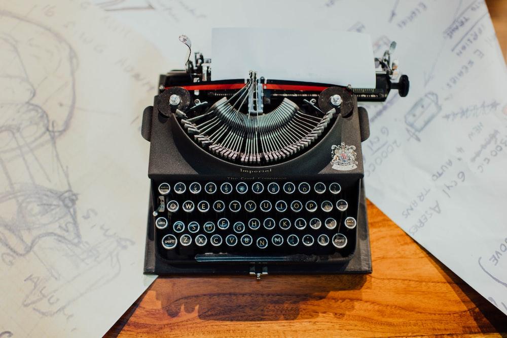 photo of black typewriter on table