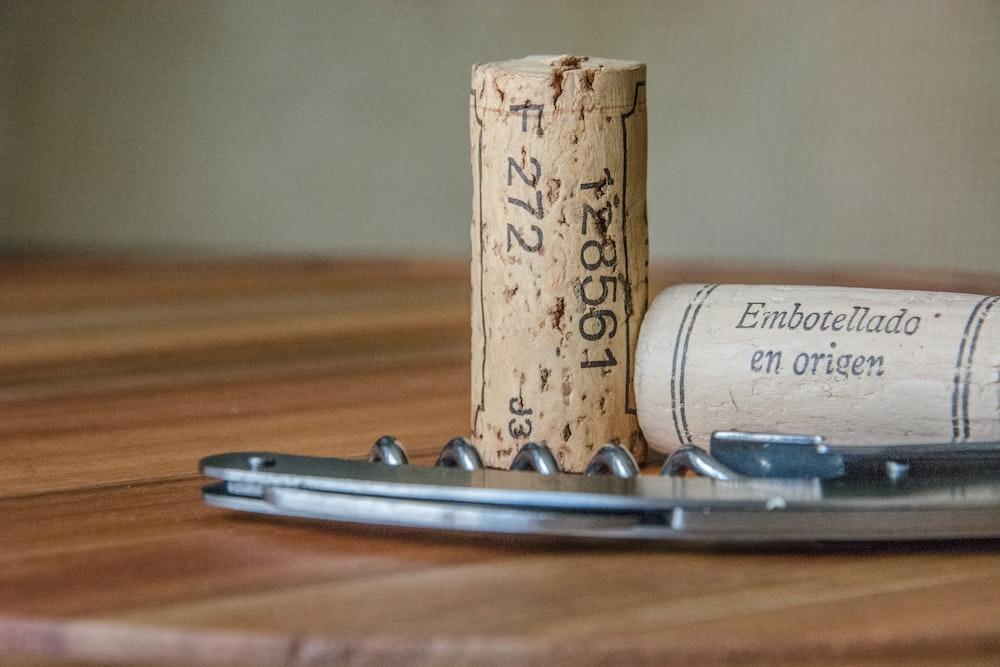 two brown cork bottle lids