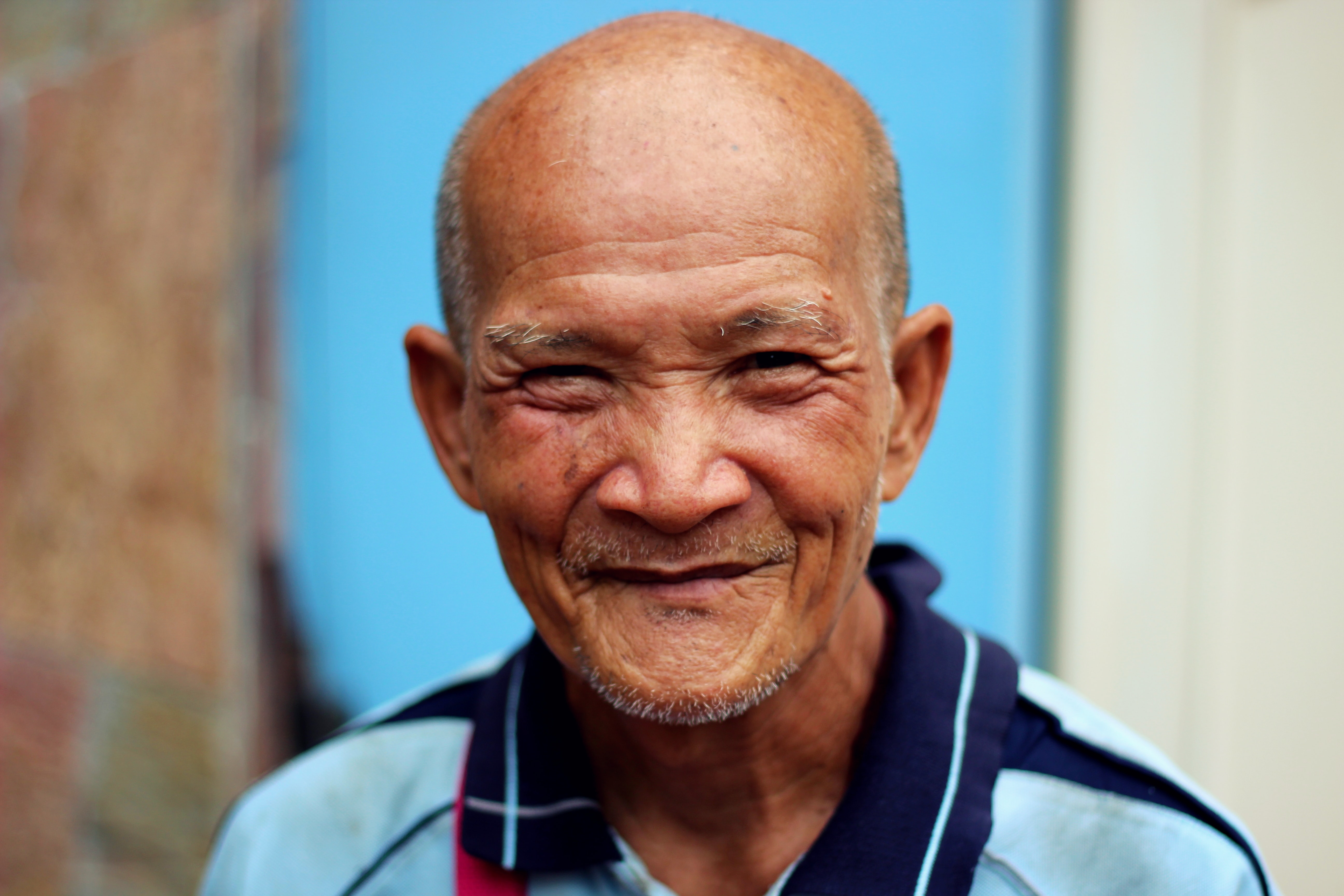 smiling man with polo shirt