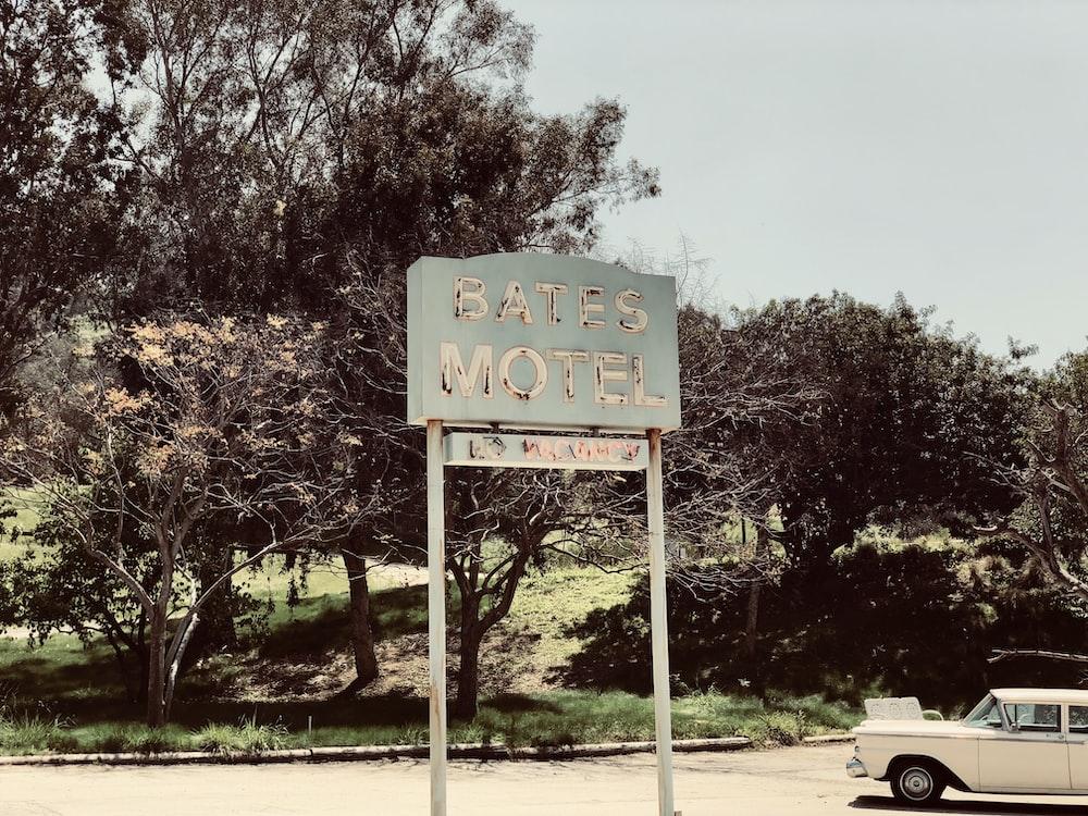 Bates Motel signage near tree