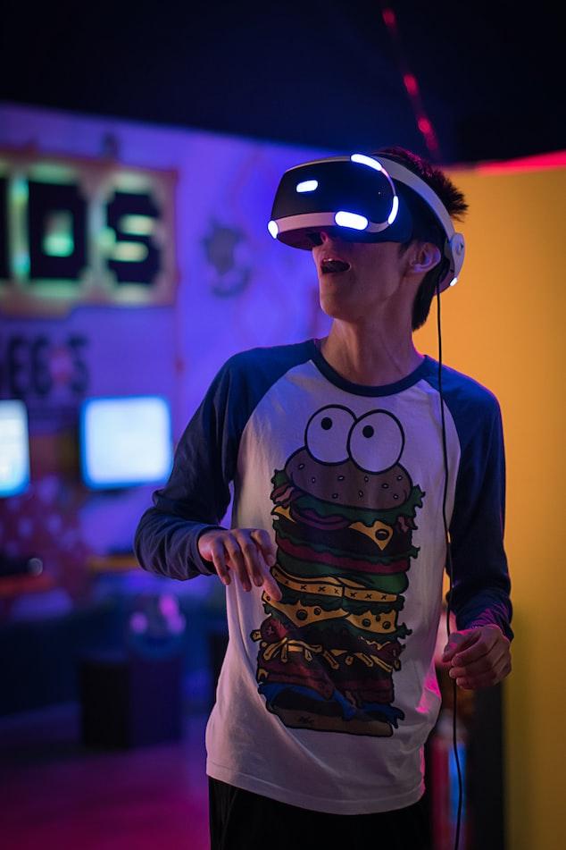 Boy playing virtual reality games at Hub Zero